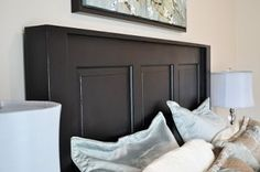 Old farm door to fabulous headboard. I have a few doors saved from our remodel that are similar to this.