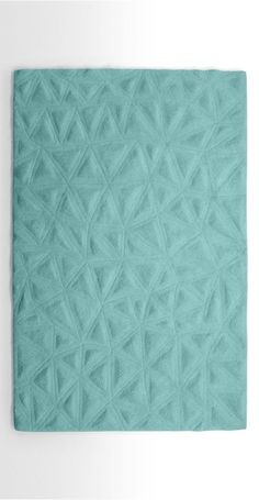 The Tekari Rug in Pale Teal. Inspired by lunar landscapes and geometric shapes. Hand carved and tufted in India. £249 | MADE.COM