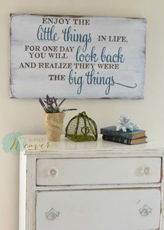 Enjoy the little things in life for one day you will look back and realize they were the big things.  Unique hand-painted sign made from reclaimed barn wood, comes ready to hang with sawtooth hangers on the back. Please keep in mind that because this sign is made from reclaimed barn wood, no two will ever be alike, and it will not look exactly like the photo.  Measures approx. 30w x 18h CURRENT LEAD-TIME UNTIL SIGN IS READY TO SHIP: 4 WEEKS  Sign is shown in white wood with dark teal and…