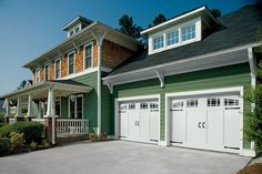 Amarr Bob Timberlake® Collection: Davidson with Seeded Glass wood carriage house style garage door. Visit www.amarr.com for more great styles.