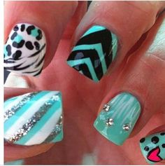 Cute cheetah/zebra print nails with a little touch of stripes!