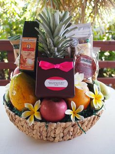 Custom Hawaiian gift basket w/fresh fruit and plumeria flowers. Only at: Exquisite Basket Expressions (Oahu, Hawaii)