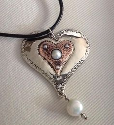 Two heart and pearl design