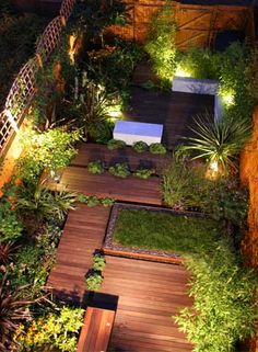 Entertaining Night Garden Wood planks, greenery, and lighting.  I wonder if this is possible on my little slab?