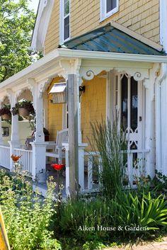 Lots of Victorian trim balanced by clean & simple rails - via Aiken House & Gardens #porch