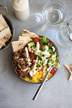 NYC Truck Halal Lamb Platter recipe from Cooking with Cocktail Rings || turmeric rice topped with seasoned ground lamb, lettuce, tomato and spiced yogurt sauce and hot sauce