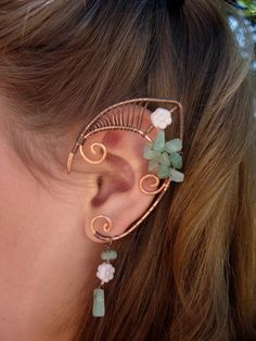 Pair of Beautiful Copper Faerie Ears with glass flower accents and Light Aventurine chips, Elf Ear Cuffs, Fairy, Renaissance, Elven. $35.00, via Etsy.