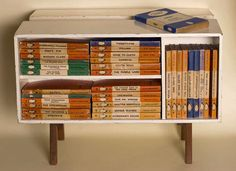 vintage penguin books in a modern bookcase of the '40s.