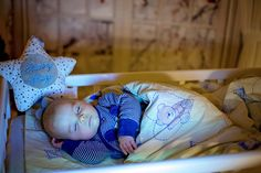 Adorable newborn baby boy, sleeping in crib at night. Little boy in blue striped pajamas taking a nap in dark room, christmas decoration in the room, winter time, snowing outdoors Take A Nap, Take That, Boy Names, Baby Boy Newborn, Winter Time, Photography Tutorials, Little Boys, Cribs, Toddler Bed