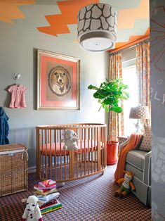 In its new state, the nursery/guest room is full of energy from touches of orange against a neutral taupe backdrop to layered patterns and child-friendly greenery. The addition of a painted zigzag pattern to the ceiling gives Orly something stimulating to look at while lying down in her crib.