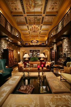 Sitting room in a mega home... I like the colors and the stone walls.