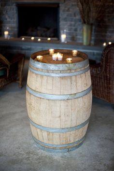 Candles on barrels. Photography by justinmarantz.com, Floral Design by hanafloraldesign.com    #whiskeybarrels #bistrotables