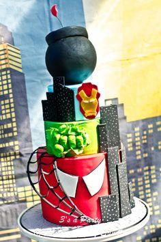 Super hero birthday cake. Love the fist punching through on the green layer.