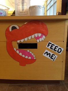 Library book return. YES! I want to have one of these. Could be other things like a hungry hippo too.