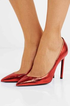 Scroll down to shop our editor's top choices for red heels that will start putting you in the holiday mood! GIANVITO ROSSI Levy patent-leather ankle boots - Gianvito Rossi's 'Levy' boots are made from high-shine patent-leather that makes the bold red hue all the more eye-catching. They have a sup