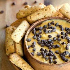 Pumpkin Chocolate Chip Cheesecake Dip - Enjoy the luscious flavors of pumpkin pie cheesecake without ever having to turn on your oven. The sprinkle of chocolate chips puts this pumpkin cheesecake dip over the top! Plus, 10 more pumpkin and chocolate chip recipes for fall.
