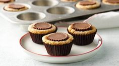 Mini muffin-size chocolate chip cookie cups cradle  creamy peanut butter and hazelnut spread for a sweet-tooth satisfying dessert.