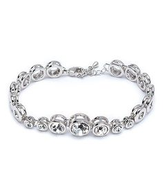 callura Swarovski® Crystal & Silvertone Round-Cut Bracelet   zulily  . $22.99 $84.00 : Product Description:  This simple bracelet embellished with Swarovski® crystals brings elegant sparkle to your look.      0.4'' W x 6.2'' L  .     Lobster claw clasp  .     Silvertone-plated metal / Swarovski® crystal  .     Imported