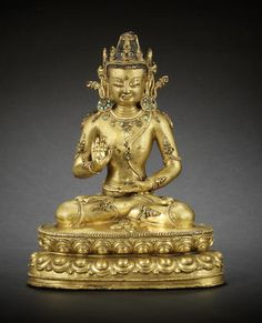 A rare gilt-bronze figure of Amoghasiddhi 14th/15th century