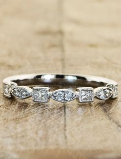 The Beatriz: a vintage-inspired diamond wedding band with an intricate design that goes 3/4 around the band. by Ken & Dana Design.