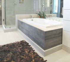 the barn siding is also used as the tub skirt the light tones of