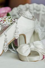The shoes waiting for the bride with tiara, earring and matching bracelet just perfect for any wedding day.