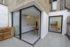 How about opening up you space with sliding corner doors! Slim glass panels slide and hide inside wall pocket creating convenient and spacious opening. - May 12 2019 at Kitchen Glass Doors, Sliding Glass Door Repair, House Extension Design, Corner Door, House, Narrow Kitchen, Glass Doors Interior, Sliding Glass Door, Sliding Doors Interior