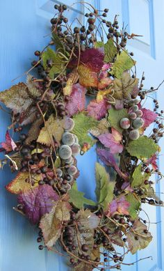 Summer Tuscan Grapevine Floral Wreath via Etsy-like this much, reminds me of playing in the grape arbors as a child.