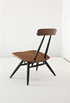 ILMARI TAPIOVAARA Low 'Pirkka' chair, c. 1960 Pine, ebonised wood. 71 cm. (28 in.) high Manufactured by Asko, Finland. Underside of seat impressed with 'LP/LAUKAAN PUUO/MADE IN FINLAND/TAPIOVAARA/DESIGN'.