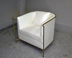 Custom armchair with solid brass frame.