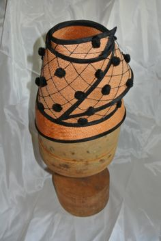 hat made from vintage parisisal straw hat with silk organza and vintage veiling.