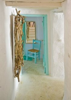 This amazing country house is located in southern Peloponnese, in Mani, Greece, and was designed by Aiolou Architects . The house feels . Deco Turquoise, Turquoise Door, Wabi Sabi, Greek Decor, Chaise Vintage, White Picture Frames, Greek House, Tadelakt, Home And Deco