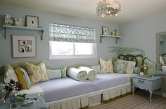 source: Sarah Richardson Design    Boho Chic girls' bedroom with blue walls paint color, vintage green twin headboards painted Para Paints Greenhouse, vintage blue nightstand painted Para Paints Brunch With Friends, pale green ceiling painted Para Paints Fireflies and green & blue roman shades.    [paint blues]  Para Paints Growing Pains decorpad.com