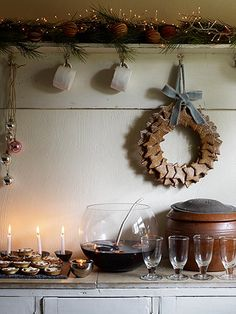 simple Christmas setting, punch, candles, gingerbread star cookie wreath, rustic