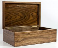 This handcrafted keepsake box showcases rich American black walnut with a Santos rosewood top panel. The box measures 8 inches wide (20.3 cm), 5 inches deep (12.7 cm), and 3 inches tall (7.6 cm). Available at $60.00.