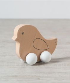 Our new collection of wooden baby toys is a huge hit, so we decided to expand it with many more fun designs! This baby chick wooden push toy is a fun way for your little to exercise their arms and gives great incentive to crawl behind it. It's made of real wood and made to last, all the way to hand-me-down-day! Available online at Hallmark Baby for a limited time.