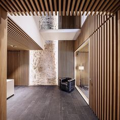Stone walls wood, organic, traditional and natural stone. Arquia Banca Office in Girona Spain Javier de las Heras Solé architects Architecture Design Concept, Contemporary Architecture, Architecture Details, Interior Architecture, Ceiling Design, Wall Design, House Design, Lobby Design, Modern Interior