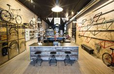 Handsome Cycle store by KNOCK, Minneapolis store design Bicycle Store, Retail Solutions, Restaurants, Retail Interior, Retail Space, Industrial House, Retail Shop, Design Furniture, Cool Bikes