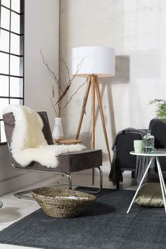 Tripod Wood floor lamp with sofa grouping.