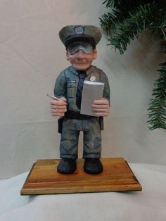Police officer wood sculpture hand carved wood policeman caricature that is great gift for policeman by Dan Easley by WeAreOutofOurGourds on Etsy https://www.etsy.com/listing/208789483/police-officer-wood-sculpture-hand