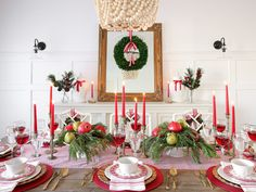 A christmas tablescape in traditional red tones featuring lots of natural greenery and gold accents. Gold Christmas, Christmas Holidays, Xmas, Christmas Table Settings, Christmas Tablescapes, Lenox Crystal, Chippendale Chairs, Preserved Boxwood, Pottery Barn
