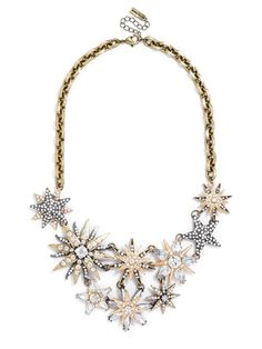 A mixed-metal bib connotes a luxe DIY vibe with an asymmetrical jumble of heavenly bodies. %0D%0A