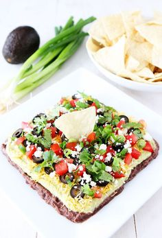 Mexican Layer Dip Recipe on http://twopeasandtheirpod.com This dip is always a hit at parties and it is easy to make too!