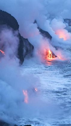 Molten #lava flowing into the sea at #Hawaii Volcanoes National Park on The Big Island of Hawaii.