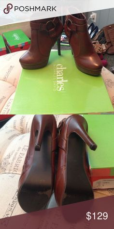 Charles David brown boots size 7 Worn a handful of times Charles David high heel platform boots size 7. Comes in original box Charles David Shoes Heeled Boots