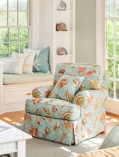 Coastal pattern on a sofa chair: http://www.completely-coastal.com/2016/03/signs-you-are-meant-to-live-by-sea.html Upholstery fabric with sea shell motif in coral and blue.