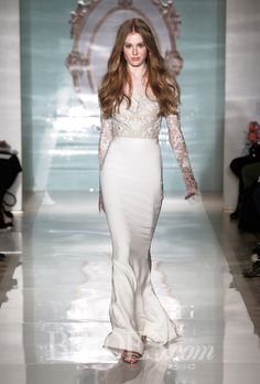Brides.com: Reem Acra - Spring 2015. Crepe sheath wedding dress with an embroidered illusion bodice and long sleeves, Reem Acra