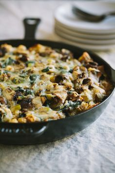 Wild Mushroom and Leek Strata with whole grain bread and melted fontina cheese
