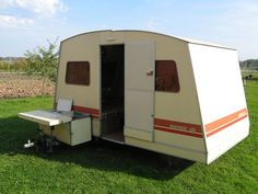 The remarkable Rapido folding caravan. Amazing space when erected but easily stored and towed. Also had its own awning which doubled the space if needed. Many a Happy holiday with our dogs was had in ours.
