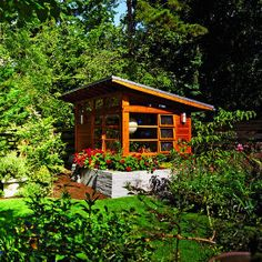 This renovated toolshed houses books, a TV and stereo, and an L-shaped counter for orchids and crafts projects.
